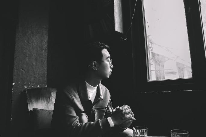 canva-grayscale-photo-of-man-sitting-near-closed-window-MADGyfjt8bc